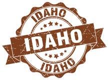 Idaho round ribbon seal. Idaho round brown ribbon seal vector illustration