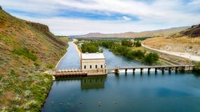 Idaho's Diversion Dam and canal water is diverted to on the Boise River. Unique view of the historic Diversion Dam on the Boise River and canal royalty free stock images