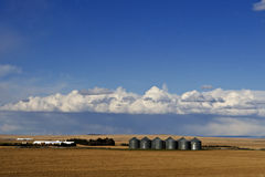 Idaho Silos. And mega farm on the wide open plains with a threatning sky and inclement weather overhead and plowed fields in the foreground American West royalty free stock image