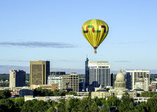 Idaho state capital with a yellow hot air balloon. Yellow hot air ballon over the IDaho capital Stock Photo