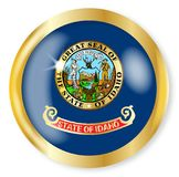 Idaho Flag Button. Idaho state flag button with a gold metal circular border over a white background Stock Photography