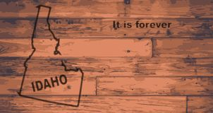 Idaho Map Brand. Idaho state map brand on wooden boards with map outline and state motto royalty free illustration