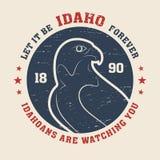 Idaho t-shirt design, print, typography, label with peregrine. Stock Photos