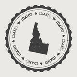 Idaho vector sticker. Hipster round rubber stamp with US state map. Vintage passport stamp with circular Idaho text and stars, USA map vector illustration Stock Photos