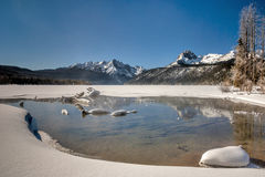 Idaho winter lake with mountain range winter snow Stock Image