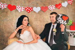 Ide and groom posing with valentines Stock Images