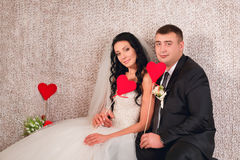 Ide and groom posing with valentines Royalty Free Stock Photos