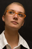 Idea. Picture of a business woman with orange glasses Royalty Free Stock Image