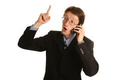 Idea. Young businessman talking on the mobile isolated on white stock photo