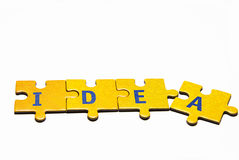 Idea. The word idea built from the puzzle pieces Royalty Free Stock Images