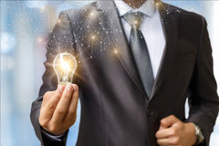 Idea as light is ignited in the hand . Stock Image