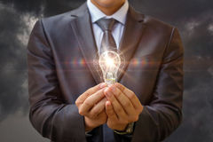 Idea as light is ignited in the hands . Royalty Free Stock Image