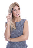 Idea: blond woman thinking with pen in hand isolated on white ba Stock Photography