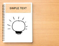 Idea book on textured wood background. Royalty Free Stock Photo