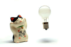 Idea is born from the beckoning cat #2. Idea bulb is born from the beckoning cat stock photos