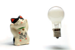 Idea is born from the beckoning cat #3. Idea bulb is born from the beckoning cat royalty free stock photography