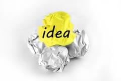 Idea. Bright idea over rough idea on white background Stock Photography