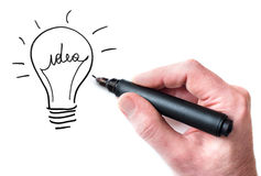 Idea bulb. Hand drawing Idea bulb on whiteboard Royalty Free Stock Photography