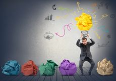 Idea. Businessman holding a drawing of new creative idea Stock Image