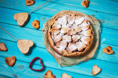 Idea for the celebration of Valentine`s Day: cherry pie with the decor  the dough in the shape  heart on wooden table. Royalty Free Stock Photography