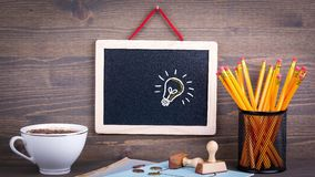 Idea. Chalkboard on a wooden desk. Business and success background stock footage