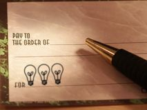 Idea Check. Check with lightbulbs in memo section Stock Photography