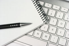 Idea. Computer keyboard. Notepad. Pen Royalty Free Stock Images