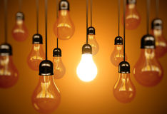 Idea concept. With light bulbs on a orange background Royalty Free Stock Photography