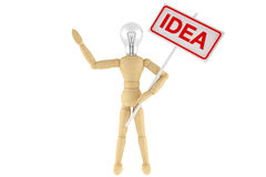 Idea Concept. Wooden mannequin with light bulb as a head on a white background Stock Images