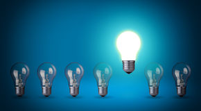 Idea concept. Row of light bulbs.Idea concept on blue background Stock Image