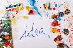 Idea concept. Creative idea concept with colorful paints over white paper Stock Image