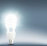 Idea concept. Bulb with light effect od blue background Stock Photos