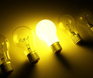 Idea concept. Luminous lamp abreast on dark background Royalty Free Stock Images