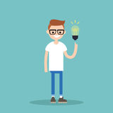 Idea Concept. Aha moment. Young smiling nerd is pointing a finger Royalty Free Stock Photo