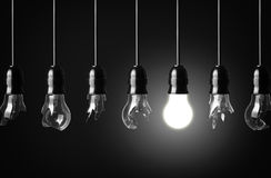 Idea concept. With broken bulbs and one glowing bulb Royalty Free Stock Photos