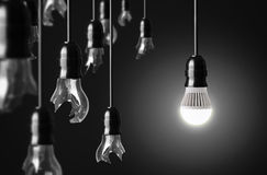 Idea concept. With broken bulbs and one LED glowing bulb Royalty Free Stock Image