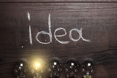 Idea concept on wooden background Royalty Free Stock Image