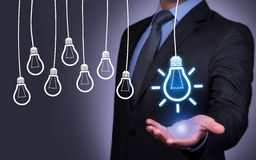 Idea Concept Bulb on Blackboard Royalty Free Stock Image