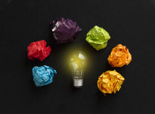 Idea concept with bulb and different colors paper wads Royalty Free Stock Photo