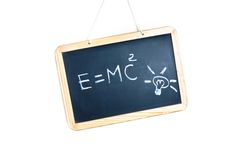 Idea concept with bulb light and energy formula on school blackboard Stock Images