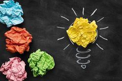 Idea concept, colorful crumpled paper on the blackboard Royalty Free Stock Photos