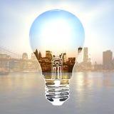 Idea concept. Creative light bulb sketch on bright city background. Idea concept. Double exposure Stock Photography