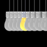 Idea concept , 3D rendering light bulbs that glowing among the others on black background. An Idea concept , 3D rendering light bulbs that glowing among the Royalty Free Stock Photos