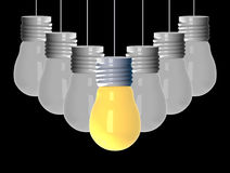 Idea concept , 3D rendering light bulbs that glowing among the others on black background. An Idea concept , 3D rendering light bulbs that glowing among the Stock Image