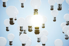 Idea concept with glowing light bulb Royalty Free Stock Image