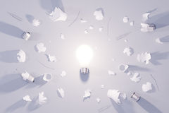 Idea concept with glowing lightbulb and broken lightbulbs Stock Image
