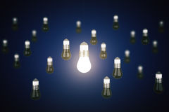 Idea concept with glowing lightbulb Stock Photos