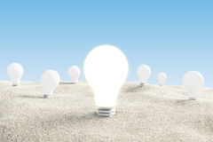 Idea concept with glowing lightbulb in desert Royalty Free Stock Photos
