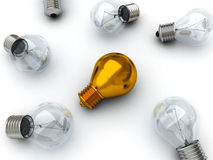 Idea concept golden lying bulb out from others Royalty Free Stock Photo