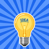Idea concept with light bulb with blue rays Stock Image